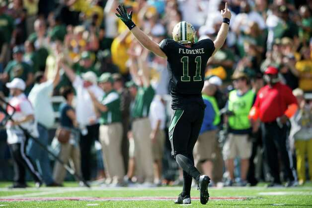 Nick Florence #11 of the Baylor University Bears celebrates a 75 yard touchdown pass to Tevin Reese #16 against the Oklahoma State University Cowboys on December 1, 2012 at Floyd Casey Stadium in Waco, Texas. Photo: Cooper Neill, Getty Images / 2012 Getty Images