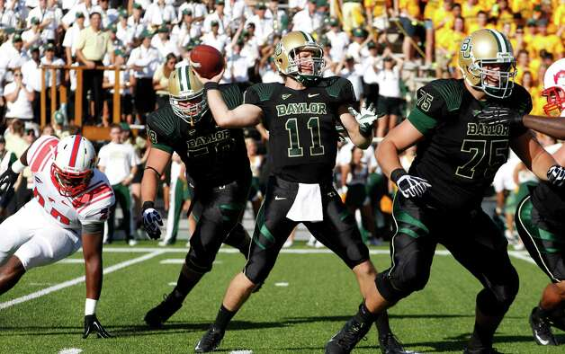 Baylor quarterback Nick Florence (11) passes from the pocket against Southern Methodist during the first half of an NCAA college football game in Waco, Texas, Sunday, Sept. 2, 2012.  (AP Photo/LM Otero) Photo: LM Otero, Associated Press / AP