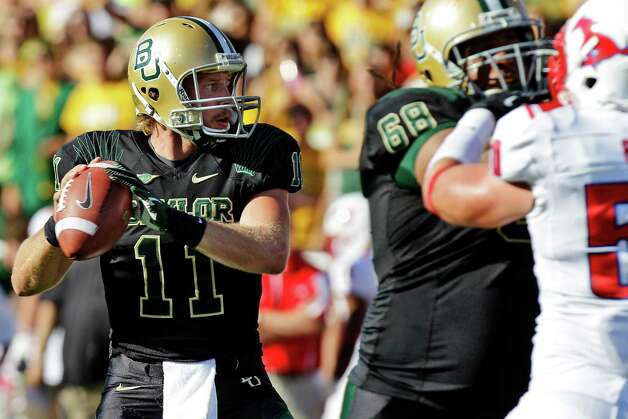 Baylor quarterback Nick Florence (11) passes as offensive tackle Cyril Richardson (68) blocks Southern Methodist linebacker Cameron Rogers (50) during the first half of an NCAA college football game in Waco, Texas, Sunday, Sept. 2, 2012. (AP Photo/LM Otero) Photo: LM Otero, Associated Press / AP