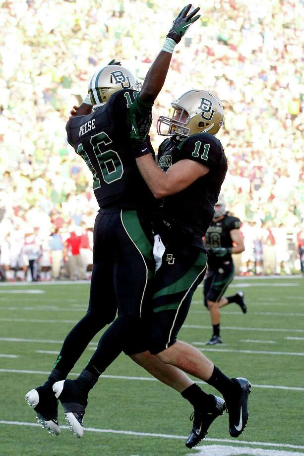Baylor wide receiver Tevin Reese (16) and quarterback Nick Florence (11) celebrate connecting for a touchdown pass during the first half of an NCAA college football game against Southern Methodist in Waco, Texas, Sunday, Sept. 2, 2012. (AP Photo/LM Otero) Photo: LM Otero, Associated Press / AP