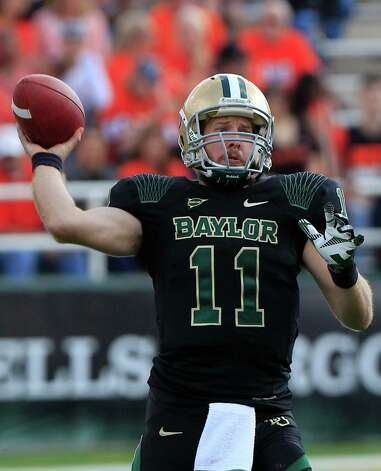 Baylor quarterback Nick Florence (11) passes during the first half of an NCAA college football game against Oklahoma State Saturday, Dec. 1, 2012, in Waco, Texas. (AP Photo/LM Otero) Photo: LM Otero, Associated Press / AP
