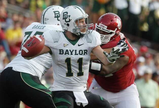Baylor quarterback Nick Florence (11) passes against Oklahoma in the second quarter of an NCAA college football game in Norman, Okla., Saturday, Nov. 10, 2012. (AP Photo/Sue Ogrocki) Photo: Sue Ogrocki, Associated Press / AP