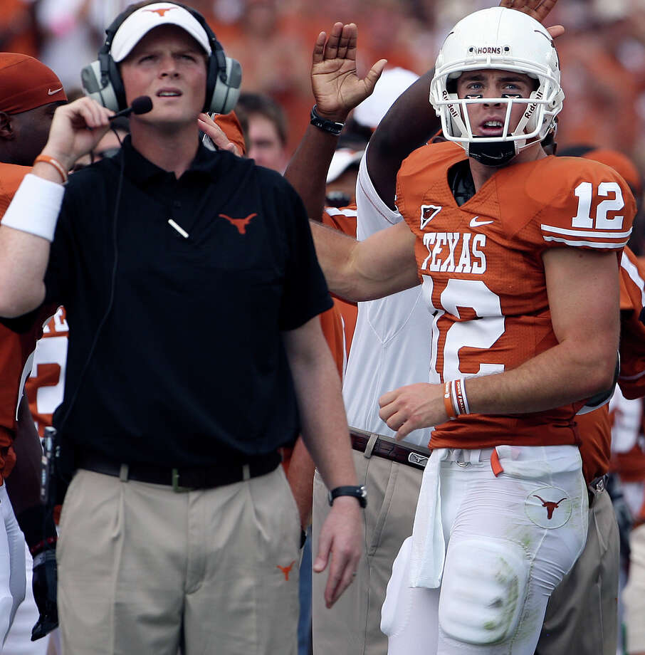 Colt McCoy returns to the sideline after a touchdown and watches the replay with Major Applewhite as Texas plays Arkansas at Memorial Stadium in Austin Saturday, September 27, 2008. Tom Reel/Staff Photo: TOM REEL, Express-News / treel@express-news.net