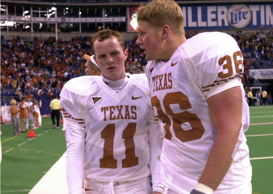 Texas' Major Applewhite, left, and Chad Stevens console one another after their loss to Colorado. BILLY CALZADA/SAN ANTONIO EXPRESS-NEWS Photo: BILLY CALZADA, Express-News / SAN ANTONIO EXPRESS-NEWS