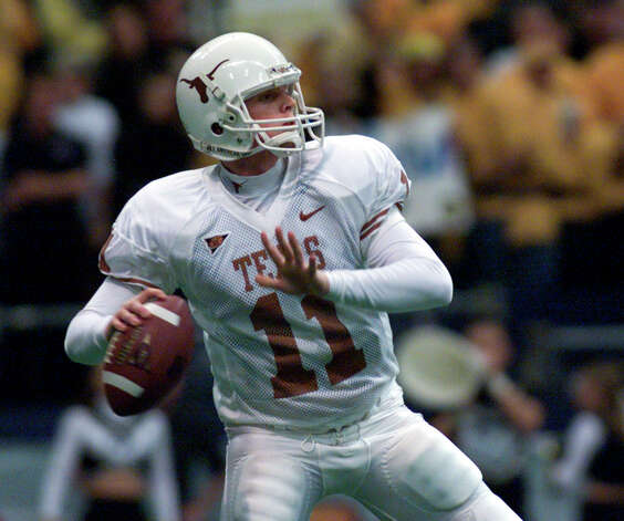 Texas quarterback Major Applewhite throws downfield in the third quarter against Colorado in the Big 12 Championship game in Irving, Texas, Saturday, Dec. 1, 2001. (AP Photo/Donna McWilliam) Photo: DONNA MCWILLIAM, Express-News / AP