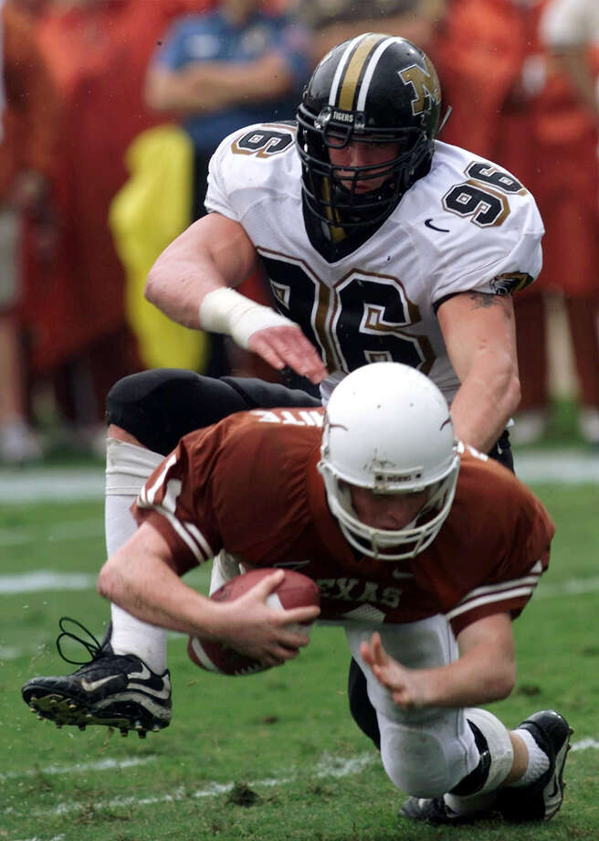 Missouri defensive end Justin Smith (96) sacks Texas quarterback Major Applewhite during the second quarter Saturday, Oct. 21, 2000, in Austin, Texas. (AP Photo/Harry Cabluck) Photo: HARRY CABLUCK, Express-News / AP