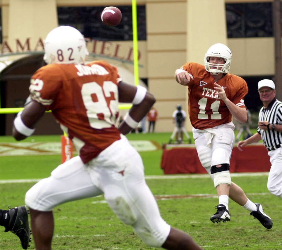 University of Texas' Major Applewhite throws downfield to B. J. Johnson. Applewhite set the school record for career passing yards in todays first half against Baylor. Texas leads at the half 31-7. Photo: Jim Sigmon, Express-News / University of Texas