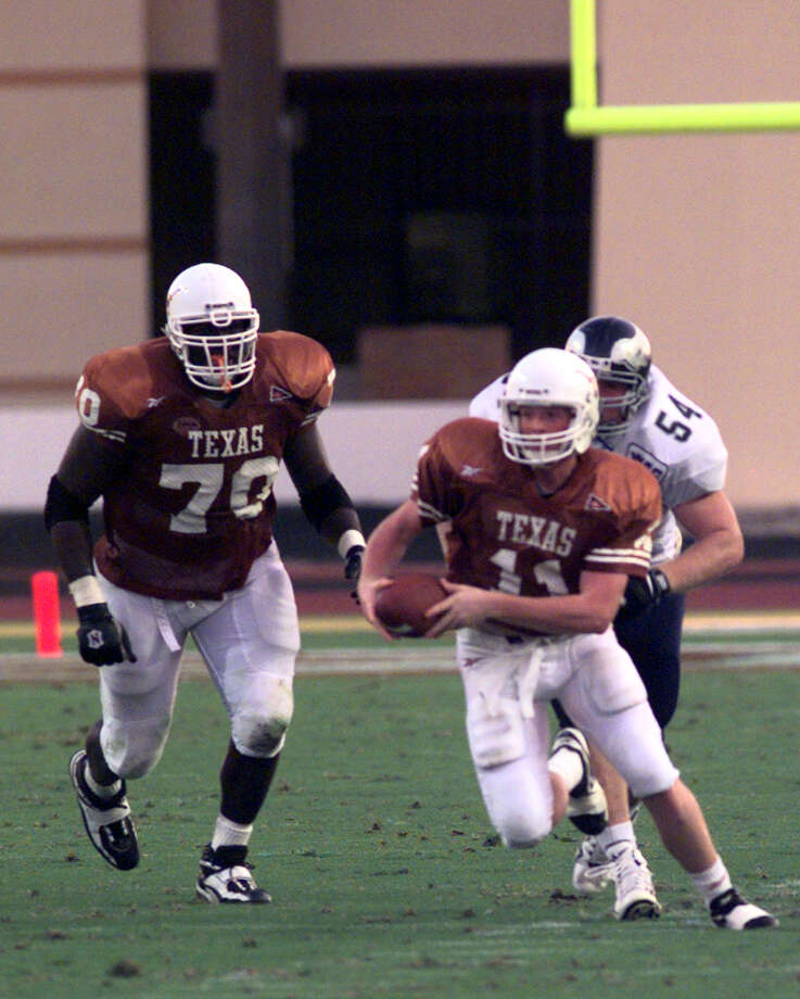 SPORTS/ DAILY??? FOR GAYLON KRIZAK -- University of Texas Quarterback, Major Applewhite, gains some yardage with a Rice University opponent hot on his tail.  UT vs. Rice University, 10/22/98, @ Austin, TX PHOTO BY DELCIA LOPEZ / STAFF Photo: DELCIA LOPEZ, Express-News / 98-4371
