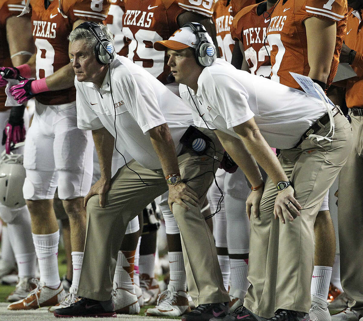 Texas co-offensive coordinator Major Applewhite (right) and head coach Mack Brown watch the Longhorns from the sidelines. Tom Reel/San Antonio Express-News