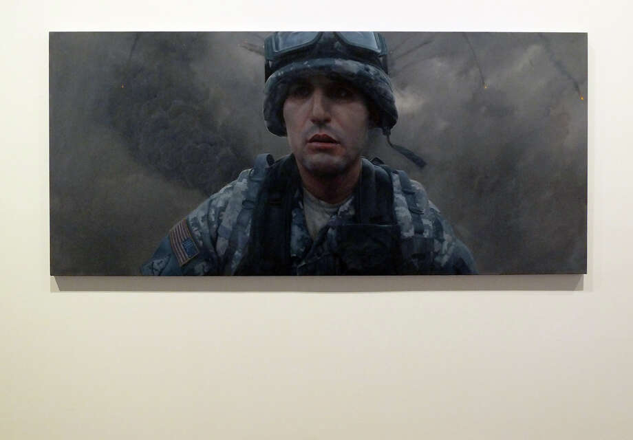 """Artist Vincent Valdez presents his solo exhibit at the McNay Art Museum on Friday, Oct. 5, 2012. A mural entitled """"John"""" is of Valdez's longtime friend and fallen soldier. Photo: Kin Man Hui, SAN ANTONIO EXPRESS-NEWS / ©2012 San Antonio Express-News"""