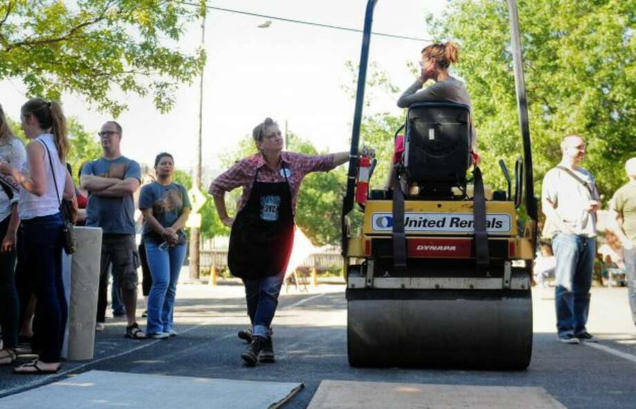This, apparently, is how we roll in Seattle. Several folks pounded out some letterpress prints using a steamroller in August. (Photo by Lindsey Wasson/Seattlepi.com.) Photo: -