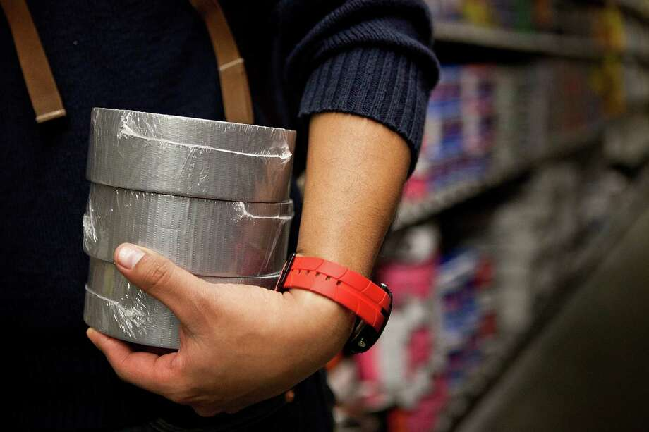 In May, a 22-year-old woman attacked police after replacing her bra with pink duct tape at a Queen Anne bar. She's since pleaded guilty to related charges. (Photo by Andrew Burton/Getty Images) Photo: Andrew Burton, - / 2012 Getty Images