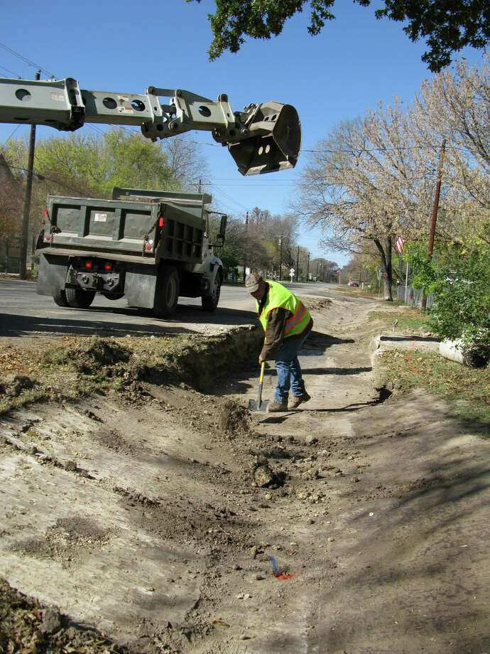 The Comfort drainage work undertaken this month by county road workers including James Justice is just minor flood control improvement compared with the dam being proposed. Photo: Zeke MacCormack, San Antonio Express-News