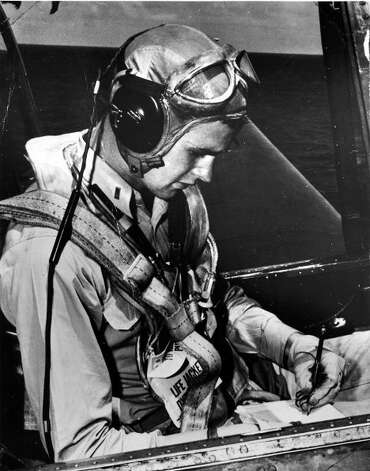 One of a series of photos from the George Bush Gallery at the Admiral Nimitz Museum in Fredericksburg. This photo shows a young George Bush in the cockpit writing in his logbook during WWII.
