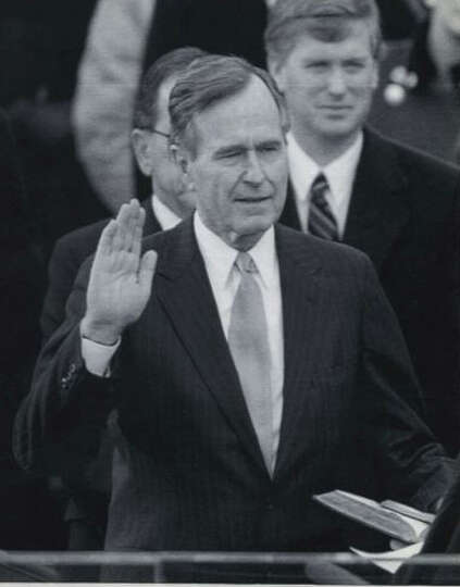 Bush takes the oath of office as  president of the United States in 1989. Vice  President Dan Qua