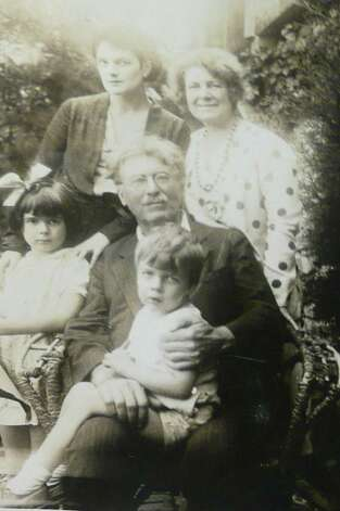 Ernest Thompson Seton sits with his grandson Seton Cottier in his lap. At his left is granddaughter Pamela. Standing, from left, are his daughter, Ann (author Anya) Seton Chase, and his wife, Grace Gallatin Seton. Photo: Anne W. Semmes
