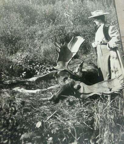 Ernest Thompson Seton's wife, Grace Gallatin Seton, stands over a bull moose she shot and killed during a Canadian canoe trip she took with her husband in 1905. The event led to Ernest Seton never using a rifle again. Photo: Anne W. Semmes