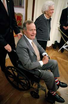 FILE - DECEMBER 26: Former U.S. President George H.W. Bush has been in and out of the hospital in Houston since early November his spokesman said on December 26, 2012, and spent Christmas in the hospital with a rising fever.  WASHINGTON, DC - MAY 31:  Former U.S. President George H.W. Bush (L) and former first lady Barbara Bush arrive in the East Room for the unveiling of former President George W. Bush's offical portrait at the White House May 31, 2012 in Washington, DC. Commissioned by the White House Historical Association, the portraits will hang in the White House next to portraits of the other past presidents. Photo: Chip Somodevilla, Getty Images / 2012 Getty Images