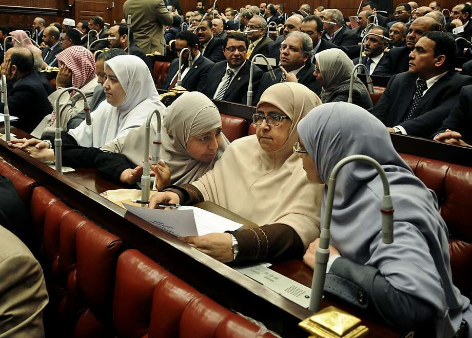 Members of the constitutional assembly speak during a session at the Shura Council building in Cairo, Egypt, Wednesday, Dec. 26, 2012. The official approval of Egypt's disputed, Islamist-backed constitution Tuesday held out little hope of stabilizing the country after two years of turmoil and Islamist President Mohammed Morsi may now face a more immediate crisis with the economy falling deeper into distress. Photo: Mohammed Asad, Associated Press