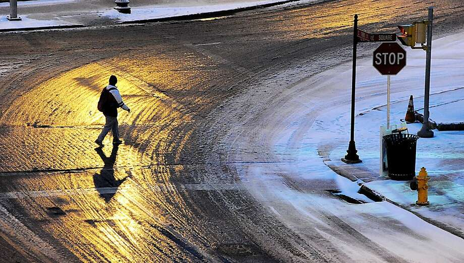 A pedestrian navigates across Third Street in Easton, Pennsylvania on Wednesday, December 26, 2012. Photo: Kevin Mingora, McClatchy-Tribune News Service