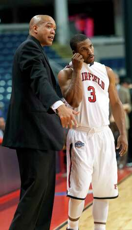 Fairfield University men's basketball head coach Sydney Johnson speaks to Derek Needham during a break in a game against Drexel University played at the Webster Bank Arena, Bridgeport, CT on Sunday December 16th, 2012. Photo: Mark Conrad / Connecticut Post Freelance