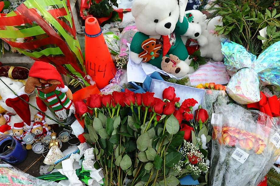 Memorials like this have been growing since the Dec. 14 shooting at Sandy Hook Elementary School, and the steady stream of visitors has been straining Newtown's resources. Photo: Christian Abraham