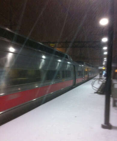 Snow coats the eastbound passenger platform at the Fairfield Railroad Station on Wednesday evening.  Fairfield CT 12/26/12 Photo: John Schwing / Fairfield Citizen contributed