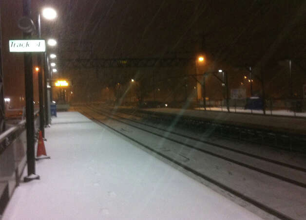 More than an inch of snow covered the passenger platforms at the Fairfield Railroad Station during the first stages of an overnight storm Wednesday.  Fairfield CT 12/26/12 Photo: John Schwing / Fairfield Citizen contributed