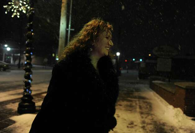 Ainsley Friedberg, of Stratford, walks through the snow on Main Street in Stratford, Conn. Wednesday, Dec. 26, 2012. Photo: Autumn Driscoll / Connecticut Post