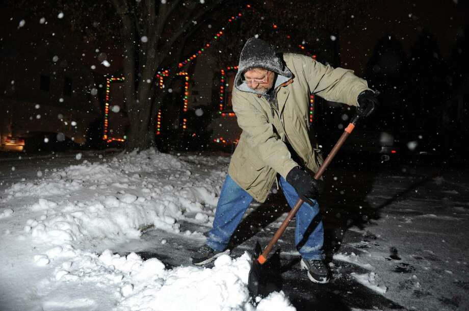 Craig Worley gets a head start on shoveling his Stratford driveway Wednesday evening, Dec. 26, 2012. Photo: Autumn Driscoll / Connecticut Post