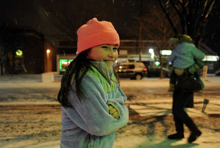 Eight-year-old Rebecca DePietro, of Stratford, braces herself against the cold wind as she leaves a restaurant with her family Wednesday, Dec. 26, 2012 in Stratford, Conn. Photo: Autumn Driscoll / Connecticut Post