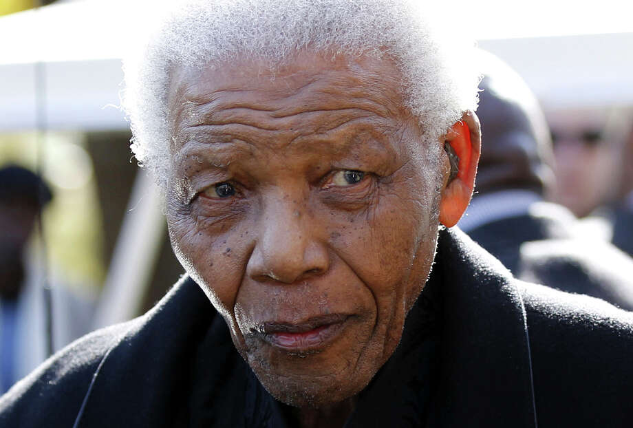 FILE - In this June 17, 2010 file photo, former South African President, Nelson Mandela  leaves the chapel after attending the funeral of his great-granddaughter Zenani Mandela in Johannesburg, South Africa. Mandela was released Wednesday, Dec. 26, 2012 from the hospital after being treated for a lung infection and having gallstones removed, a government spokesman said. (AP Photo/Siphiwe Sibeko, Pool, File) Photo: Siphiwe Sibeko