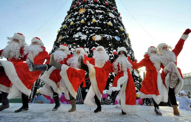 People wearing Father Frost outfits dance during a traditional pre-New Year parade in central Minsk on December 23, 2012. Photo: VIKTOR DRACHEV, AFP/Getty Images / AFP ImageForum