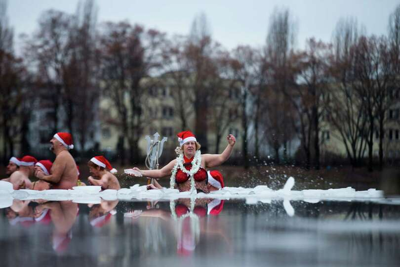 Members of the ice swimming club Berlin Seals attend the annual Christmas swimming at the partial fr