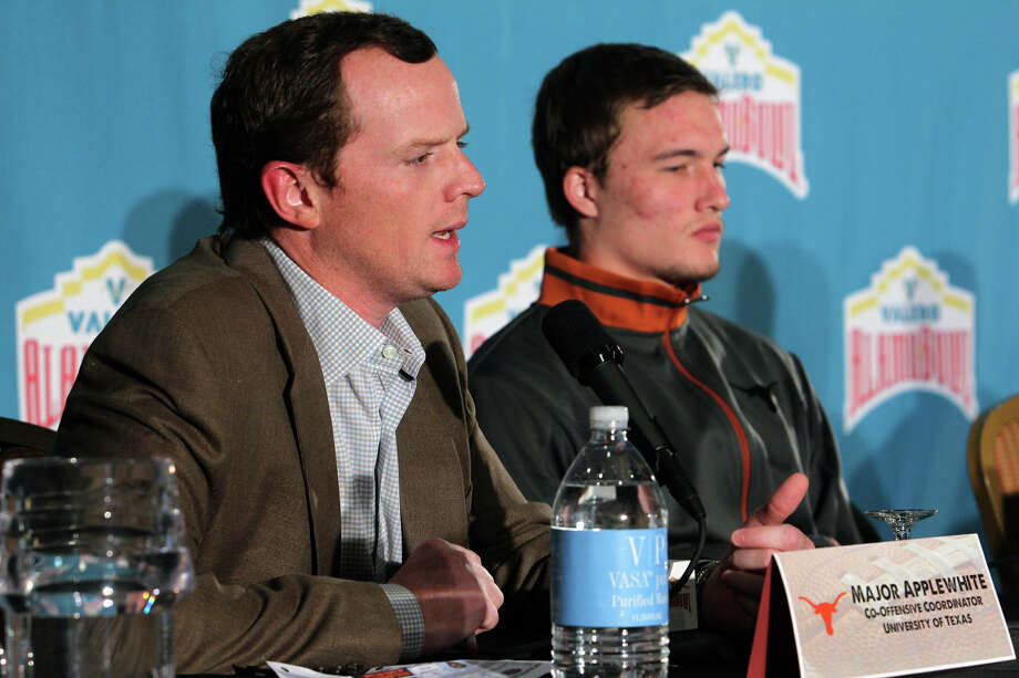 Major Applewhite speaks about the UT offense with quarterback David Ash listening as Texas and Oregon State hold news conferences at the Marriott Riverwalk on December 26, 2012. Photo: Tom Reel, San Antonio Express-News / ©2012 San Antono Express-News