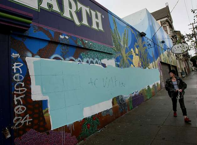 A mural at Grove and Divisadero streets, above, is painted over after it had been vandalized by graffiti repeatedly. Photo: Brant Ward, The Chronicle