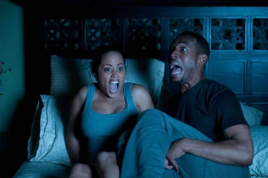 "Essence Atkins and Marlon Wayans play a couple in ""A Haunted House."" Photo: Open Road Films"