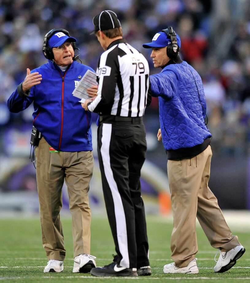 New York Giants head coach Tom Coughlin, left, protests a call with head linesman Kent Payne (79) and another member of the Giants staff in the first half of an NFL football game against the Baltimore Ravens in Baltimore, Sunday, Dec. 23, 2012. (AP Photo/Gail Burton) Photo: Gail Burton