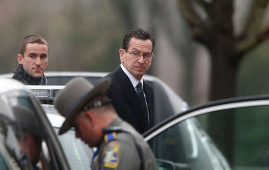 Connecticut Gov. Dannel Malloy arrives at a funeral service for 6-year-old Noah Pozner, Monday, Dec. 17, 2012, in Fairfield, Conn.  Pozner was killed when a gunman walked into Sandy Hook Elementary School in Newtown Friday and opened fire, killing 26 people, including 20 children. Photo: Jason DeCrow, (AP Photo/Jason DeCrow) / Associated Press