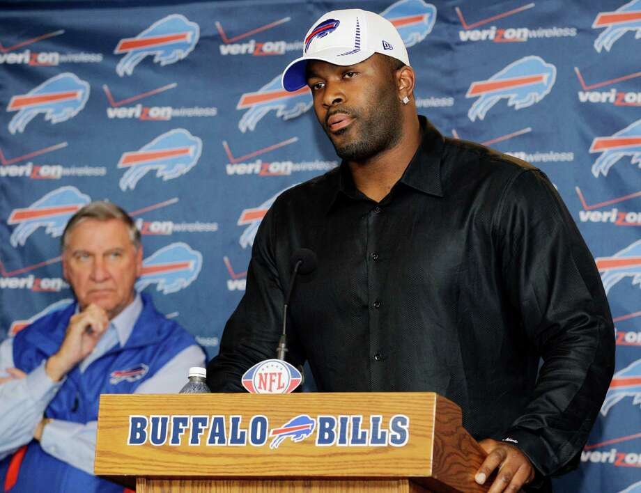 Buffalo Bills' Mario Williams, right, speaks as general manager Buddy Nix listens during an NFL football news conference after signing with the team in Orchard Park, N.Y., Thursday, March 15, 2012. Williams signed a contract touted as the richest ever given to an NFL defensive player _ a deal worth up to $100 million with $50 million guaranteed, according to his agent, Ben Dogra. (AP Photo/David Duprey) Photo: David Duprey / AP