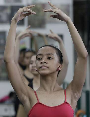 Jessa Balote rehearses with her ballet class. Photo: Aaron Favila, Associated Press