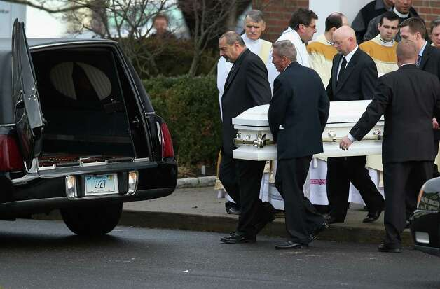 NEWTOWN, CT - DECEMBER 18:  A casket carrying the body of shooting victim Jessica Rekos, 6, is brought out after her funeral at the St. Rose of Lima Catholic church on December 18, 2012 in Newtown, Connecticut. Funeral services were held at the church for both Jessica and James Mattioli, 6, Tuesday, four days after 20 children and six adults were killed at Sandy Hook Elementary School. (Photo by John Moore/Getty Images) Photo: John Moore / Getty Images