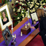 A mourner pays her respects at a funeral service for shooting victim Lauren Rousseau, Thursday, Dec. 20, 2012, at the First Congregational Church in Danbury, Conn.