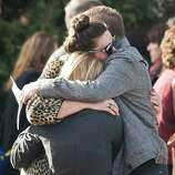 Family and friends hug each other after the memorial service for Sandy Hook Elementary School teacher Lauren Rousseau at the First Congregational Church on Deer Hill Avenue in Danbury. Thursday, Dec. 20, 2012