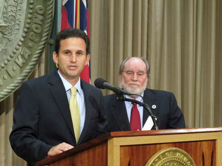 Hawaii Lt. Gov. Brian Schatz speaks the state Capitol in Honolulu on Wednesday, Dec. 26. 2012 after Gov. Neil Abercrombie, right, announced he was appointing Schatz to fill the seat vacated by the late U.S. Sen. Daniel Inouye. (AP Photo/Audrey McAvoy) Photo: Audrey McAvoy