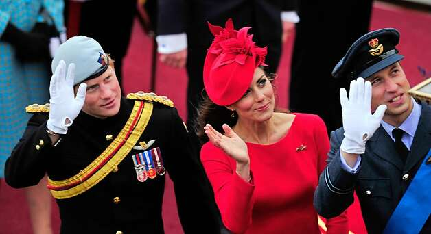 -- AFP PICTURES OF THE YEAR 2012 -- Britain's Catherine, Duchess of Cambridge, (C) Prince William (R) and Prince Harry (L) wave as they pass the Houses of Parliament aboard the Royal barge, 'Spirit of Chartwell' in central London, on June 3, 2012, during the Thames Diamond Jubilee Pageant. Hundreds of rowing boats, barges and steamers filled the River Thames with a blaze of colour on Sunday as Queen Elizabeth II sailed through London as part of her spectacular diamond jubilee pageant.   AFP PHOTO / GLYN KIRKGLYN KIRK/AFP/Getty Images Photo: Glyn Kirk, AFP/Getty Images