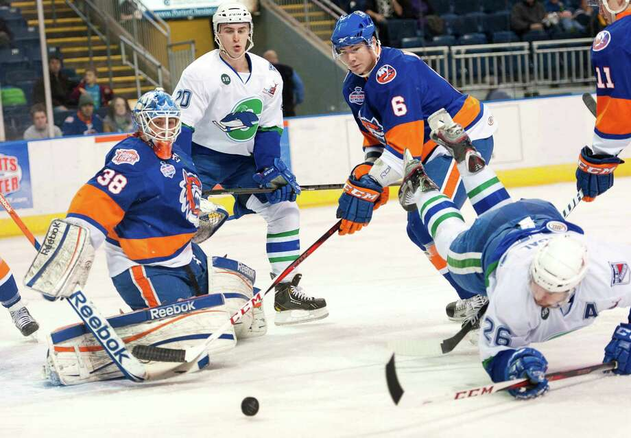 Connecticut Whale's Brandon Segal (26) tries to get a shot by Bridgeport Sound Tigers goalie Kevin Poulin (38) in an American League hockey game played at the Webster Bank Arena in Bridgeport, CT on Wednesday December 26th, 2012. Photo: Mark Conrad / Connecticut Post Freelance