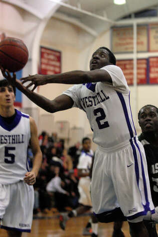 Westhill's Terrell Middleton rebounds as Bassick and Westhill High Schools face off in the Paul Kuczo Holiday BasketballTournament at Brien McMahon High School in Norwalk, Conn., Dec. 26, 2012. Photo: Keelin Daly / Stamford Advocate Riverbend Stamford, CT
