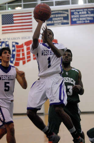 Westhill's Jeremiah Livingston shoots as Bassick and Westhill High Schools face off in the Paul Kuczo Holiday BasketballTournament at Brien McMahon High School in Norwalk, Conn., Dec. 26, 2012. Photo: Keelin Daly / Stamford Advocate Riverbend Stamford, CT