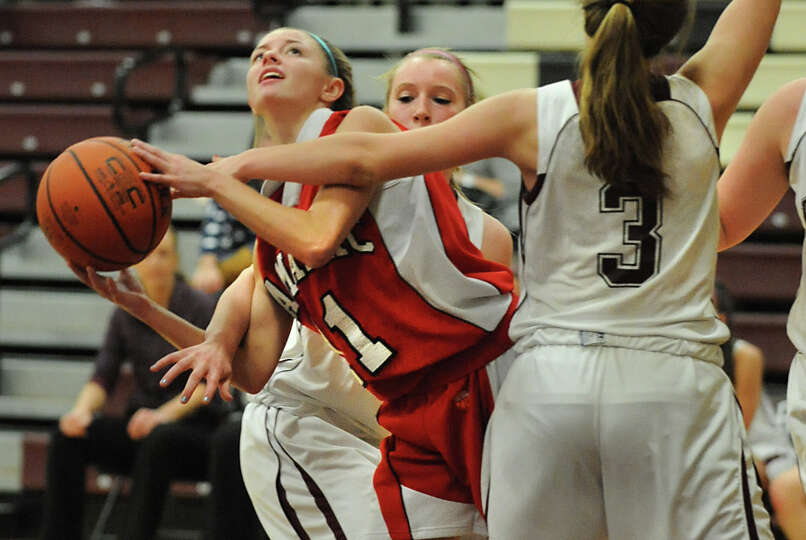 Tamarac's Jenna Erickson is fouled as she looks for the hoop during a basketball game against Burnt